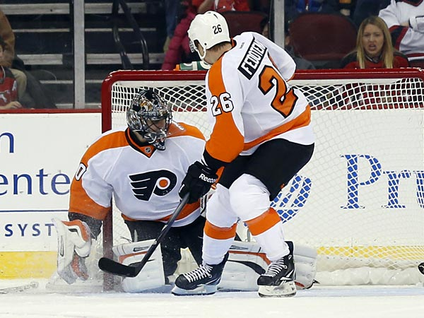 New Jersey Devils center David Clarkson (23) watches as his shot<br />enters the Philadelphia Flyers net against goalie Ilya Bryzgalov,<br />center, of Russia, and left wing Ruslan Fedotenko (26), of the<br />Ukraine, during the first period of an NHL hockey game, Tuesday, Jan.<br />22, 2013, in Newark, N.J. (AP Photo/Julio Cortez)