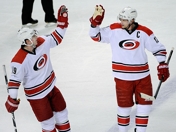 The Hurricanes´ Jiri Tlusty (19), of the Czech Republic, celebrates his empty net goal with Eric Staal (12) during the third period of an NHL hockey game against the Buffalo Sabres in Buffalo, N.Y., Thursday, Jan. 23, 2014. Carolina won 5-3. (Gary Wiepert/AP)