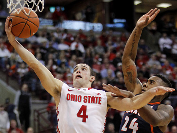 Ohio State´s Aaron Craft, left, goes up for a shot against Illinois´ Rayvonte Rice during the second half of an NCAA college basketball game in Columbus, Ohio, Thursday, Jan. 23, 2014. Ohio State won 62-55. (Paul Vernon/AP)