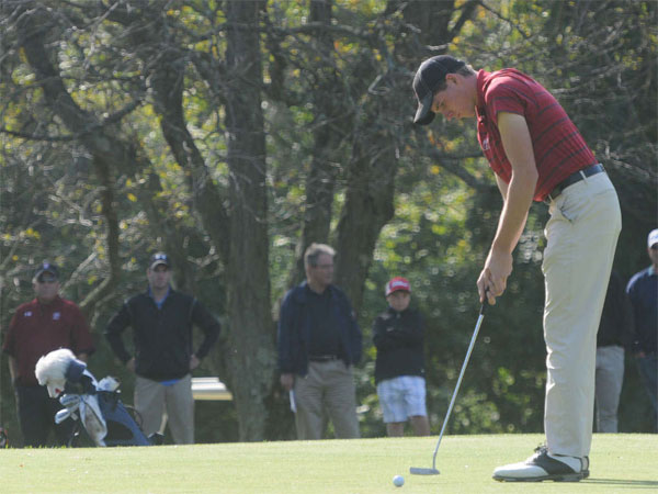 Temple´s Brandon Matthews watches his putt as it is about to drop into the seventh hole at Philmont Country Club during the Big Five Golf Invitational in 2012. (Curt Hudson / For The Inquirer)