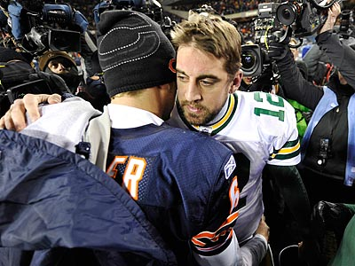 Aaron Rodgers and Jay Cutler greet each other on the field after the Packers&acute;<br />21-14 win over the Bears in the NFC Championship. (Jim Prisching/AP)