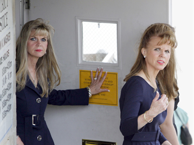 State Sen. Jane Orie (right) and sister Janine leaving a magistrate´s office in Pittsburgh after surrendering in 2010. They face a retrial Feb. 27. (Keith Srakocic / Associated Press)