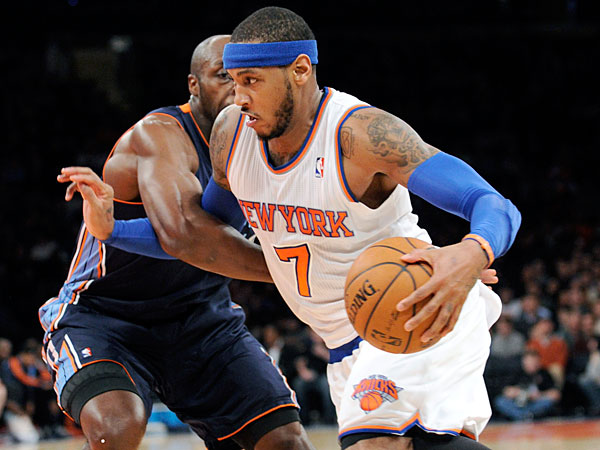 The Knicks´ Carmelo Anthony, right, drives by Charlotte Bobcats´ Anthony Tolliver during the second quarter of an NBA basketball game, Friday, Jan. 24, 2014, at Madison Square Garden in New York. (Bill Kostroun/AP)