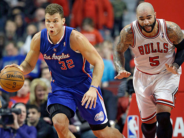 Clippers forward Blake Griffin, left, controls the ball against Chicago Bulls forward Carlos Boozer during the first half of an NBA basketball game in Chicago on Friday, Jan. 24, 2014. (Nam Y. Huh/AP)