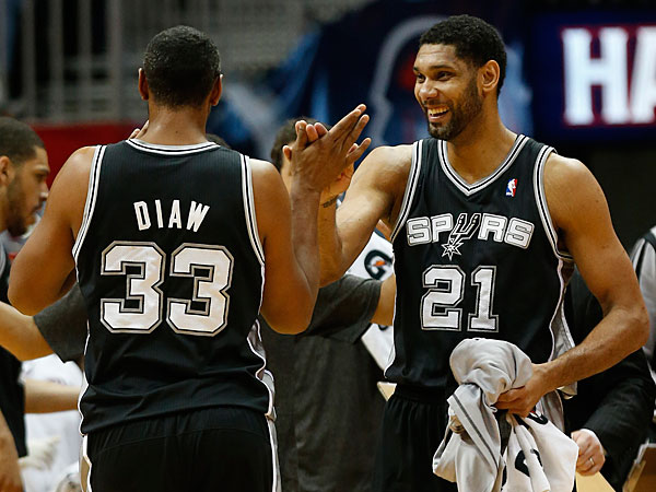 Spurs power forward Boris Diaw (33) celebrates with teammate Tim Duncan after hitting a three-point basket in the second half of an NBA basketball game against the Atlanta Hawks Friday, Jan. 24, 2014, in Atlanta. San Antonio won 105-79. (John Bazemore/AP)