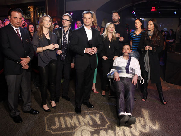 "In this Thursday, Jan. 24, 2013 photo provided by ABC, Oscar winner Matt Damon hosts ""Jimmy Kimmel Live"" after opening the show as a kidnapper, tying Kimmel, seated, to a chair with duct tape and gagging him with his own tie, on the set in Hollywood, Calif. Surrounding Damon and Kimmel are, standing from left, guests Andy Garcia, Amy Adams, Gary Oldman, Reese Witherspoon, Ben Affleck, Sarah Silverman and Demi Moore. (AP Photo/ABC, Randy Holmes)"