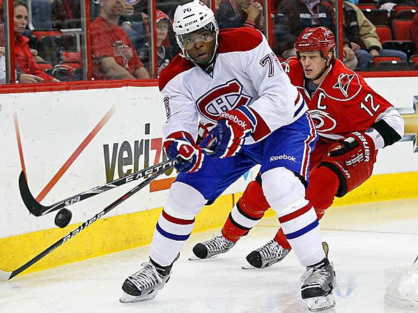 Montreal Canadiens´ P.K. Subban controls the puck as Carolina Hurricanes´ Eric Staal (12) chases during the first period of an NHL hockey game in Raleigh, N.C., Thursday, April 5, 2012. (AP Photo/Gerry Broome)