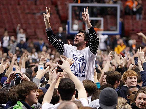 Villanova fans storm the court after the upset of No. 3 Syracuse. (Ron Cortes/Staff Photographer)