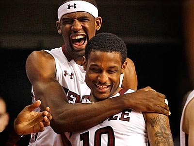 Temple´s Ramone Moore and Anthony Lee celebrate in the closing minutes against St. Joe´s. (Ron Cortes/Staff Photographer)