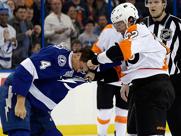 Luke Schenn (22) fights with Tampa Bay Lightning center Vincent Lecavalier (4) during the first period of an NHL hockey game Sunday, Jan. 27, 2013, in Tampa, Fla. (Chris O´Meara/AP)
