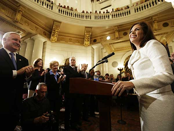 Gov. Tom Corbett and others applaud Pennsylvania Attorney General Kathleen Kane after she took her oath of office at the state Capitol in Tuesday, Jan. 15, 2013, in Harrisburg, Pa. Kane is first woman and first Democrat to be elected Pennsylvania attorney general. (AP Photo/Matt Rourke)