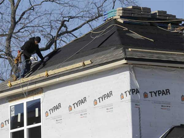In this Friday, Dec. 27, 2013, photo, a construction worker builds a new home in Wilmette, Ill. The Commerce Department releases new home sales for December on  Monday, Jan. 27, 2014. (AP Photo/Nam Y. Huh)