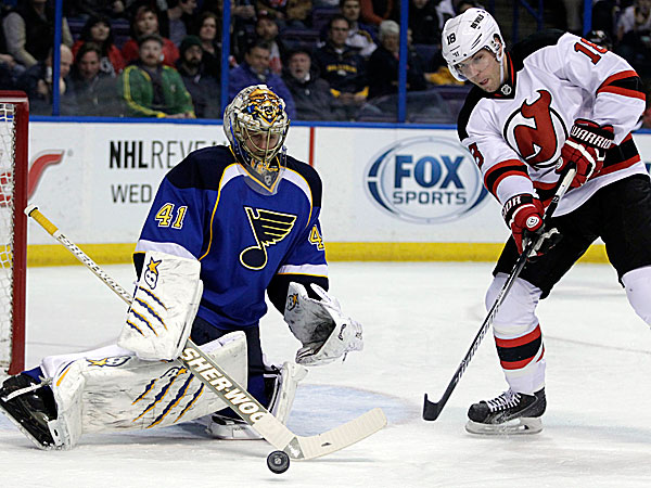 Blues goalie Jaroslav Halak makes a stick save on a point blank shot from the Devils´ Steve Bernier. (Tom Gannam/AP)