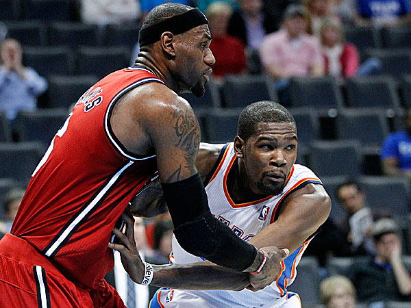 Heat forward LeBron James and Thunder forward Kevin Durant. (Sue Ogrocki/AP)