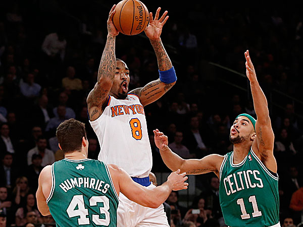 Knicks guard J.R. Smith passes as Celtics center Kris Humphries and Celtics guard Jerryd Bayless. (Kathy Willens/AP)