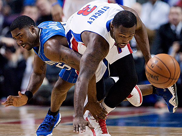 Magic guard E´Twaun Moore trips up Pistons guard Rodney Stuckey while chasing a loose ball. (Duane Burleson/AP)
