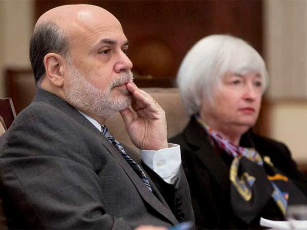 Federal Reserve Chairman Ben Bernanke with Janet Yellen, who will succeed him next week. Yellen is likely to continue a pullback in the Fed´s economic stimulus. (Bloomberg)