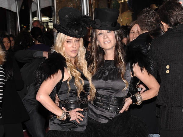 Juicy Couture founders Pamela Skaist-Levy, left, and Gela Nash-Taylor attend the Juicy Couture Fifth Avenue flagship store opening party on Thursday, Nov. 6, 2008 in New York.  (AP Photo/Evan Agostini)