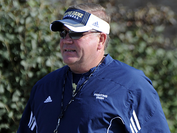 Notre Dame football coach Brian Kelly walks over to practice August 8, 2012 in South Bend, Ind. (AP Photo/Joe Raymond)