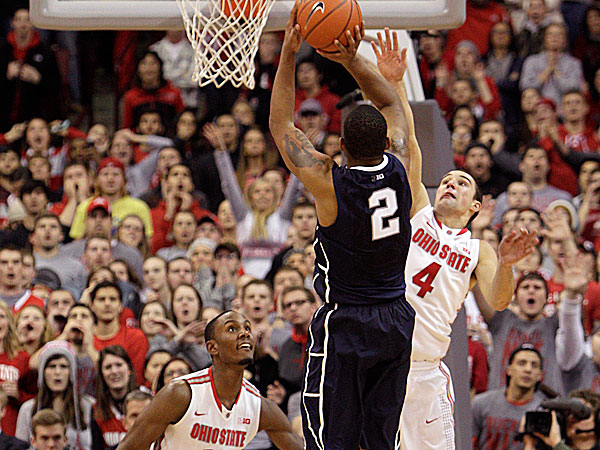 Penn State´s DJ Newbill makes the game-winning shot as Ohio State´s Aaron Craft and Sam Thompson defend during overtime. (Jay LaPrete/AP)