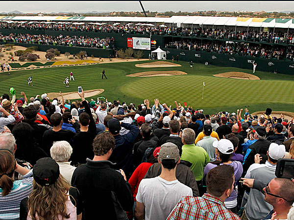 Crowds greet a group of golfers at the 16th hole of the Phoenix Open. (Ross D. Franklin/AP)