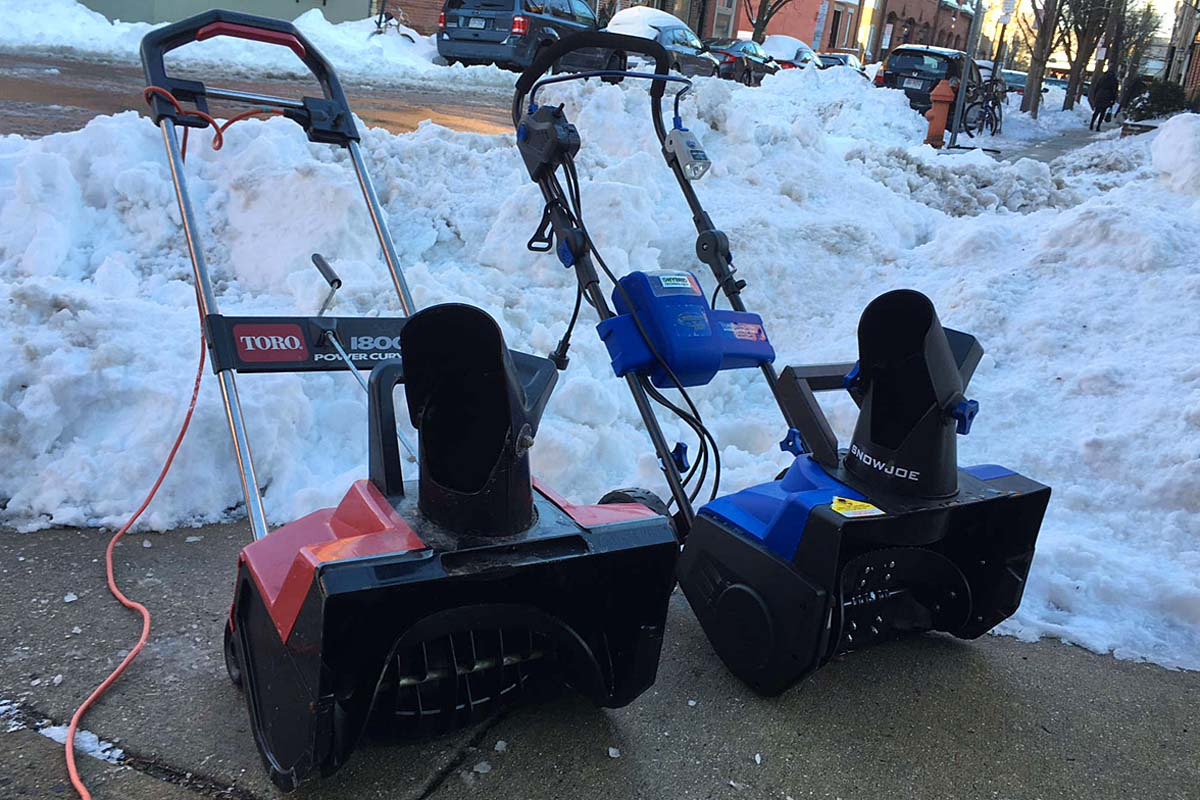 Hybrid Snow Joe (right) and plug-in Toro electric snow blowers have different benefits for cleanup.<br />