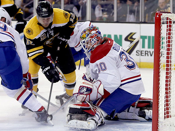 Canadiens goalie Peter Budaj  makes a save as Bruins right wing Jarome Iginla (12) looks for a rebound. (Mary Schwalm/AP)