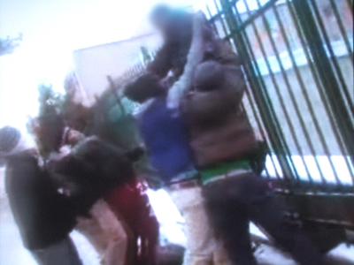 A 13-year-old is hung on a fence by his coat in Upper Darby at the hands of six bullies. This is a frame grab from raw video footage of the incident, provided by the Upper Darby Police Department.