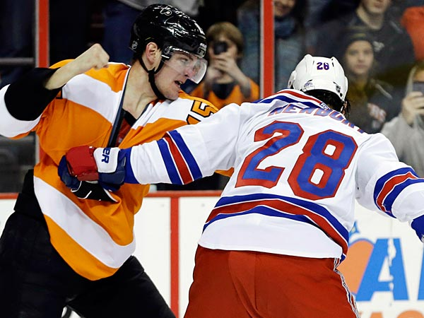 Philadelphia Flyers&acute; Tye McGinn, left, and New York Rangers&acute; Kris<br />Newbury fight during the second period of an NHL hockey game,<br />Thursday, Jan. 24, 2013, in Philadelphia. (AP Photo/Matt Slocum)
