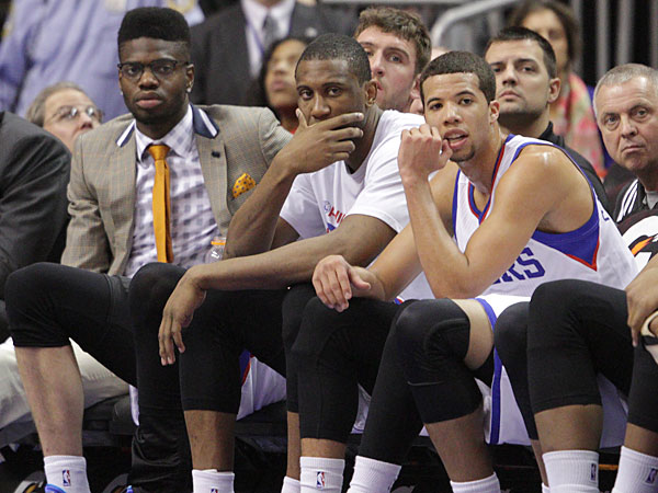 Sixers bench watches the Hawks beat them during the fourth quarter. (Steven M. Falk/Staff Photographer)