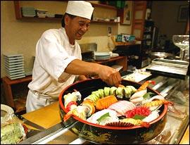 Sushi chef Jong Mok Lim prepares a platter for customers.                                      (Yong Kim/Daily News)
