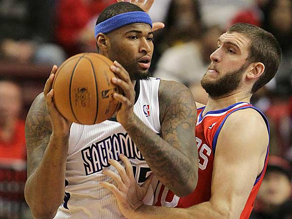 Spencer Haws guards the Kings´ DeMarcus Cousins during the first quarter of a game last season. (Steven M. Falk/Staff file photo)