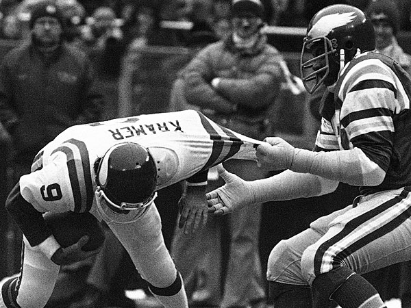 The Eagles´ Claude Humphrey,right, uses Minnesota Vikings quarterback Tommy Kramer´s jersey for a handle as Kramer is sacked for a 14-yard loss in an NFC playoff football game at Philadelphia. Humphrey was elected to the Pro Football Hall of Fame on Saturday, Feb. 1, 2014. (Rusty Kennedy/AP File)
