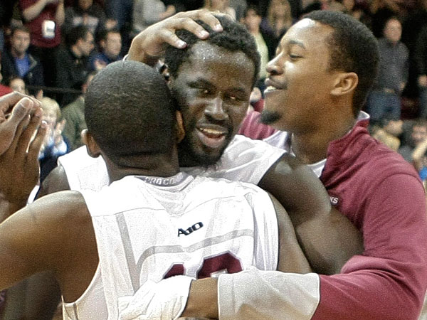 St. Joe´s Papa Ndao (facing camera) gets a pat on the head after the game. (Elizabeth Robertson/Staff Photographer)