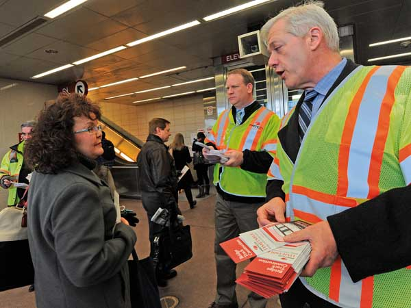 DRPA acting CEO John Hanson, PATCO general manager John Rink and DRPA Director of Transit Services Pat McBride meet commuters and hand out brochures informing riders of the new schedule at the Lindenwold PATCO station in January. (APRIL SAUL  / Staff )