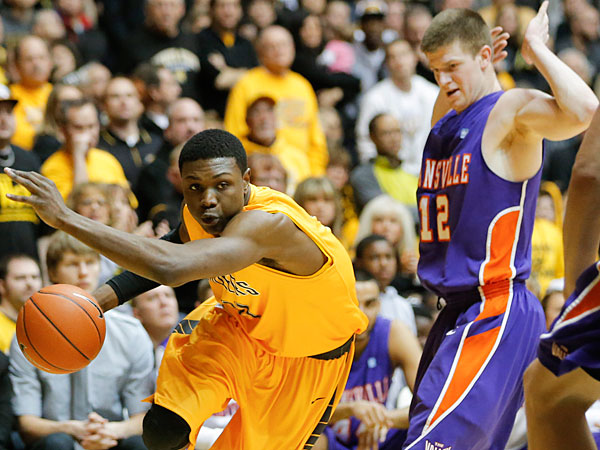 Wichita State´s Cleanthony Early, left, tries to get past Evansville´s Adam Wing during the first half of an NCAA college basketball game in Wichita, Kan., Saturday, Feb. 1, 2014. (AP Photo/The Wichita Eagle, Travis Heying)