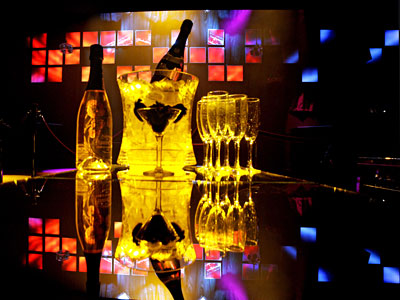Two bottles of bubbly are atop a table at Whisper, a two-month-old nightspot on Walnut Street. (ELIZABETH ROBERTSON / Staff Photographer)