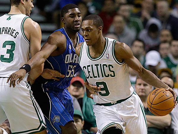 Celtics guard Rajon Rondo looks for an opening around Magic guard E´Twaun Moore as Celtics center Kris Humphries applies pressure. (Steven Senne/AP)