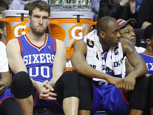 76ers center Spencer Hawes (00) and guard James Anderson (9) sit on the bench during the fourth quarter of a 113-96 loss to the Detroit Pistons. (Duane Burleson/AP)
