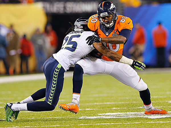 The Seahawks´ Richard Sherman stops the Broncos´ Julius Thomas. (Paul Sancya/AP)