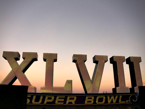 A Super Bowl XLVII sculpture sits on a barge along the Riverwalk , Saturday, Feb. 2, 2013, in New Orleans. The Baltimore Ravens play the San Francisco 49ers in NFL football´s Super Bowl XLVII on Sunday. (AP Photo/Gene J. Puskar)