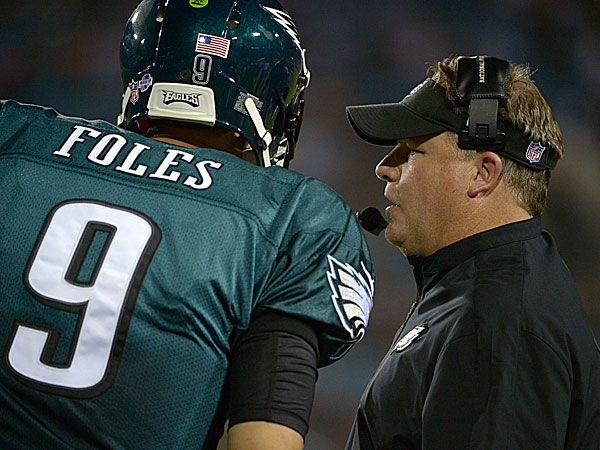 Eagles quarterback Nick Foles and head coach Chip Kelly. (Phelan M. Ebenhack/AP file photo)