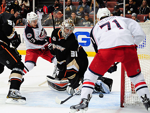 Blue Jackets right wing Cam Atkinson assists teammate left wing Nick Foligno as he scores on Ducks goalie Frederik Andersen. (Gus Ruelas/AP)