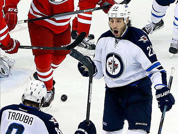 The Jets´ Chris Thorburn celebrates his go-ahead goal with teammate Jacob Trouba. (Karl B DeBlaker/AP)