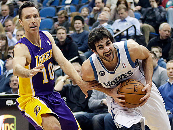 The Timberwolves´ Ricky Rubio tries to break away from the Lakers´ Steve Nash. (Jim Mone/AP)