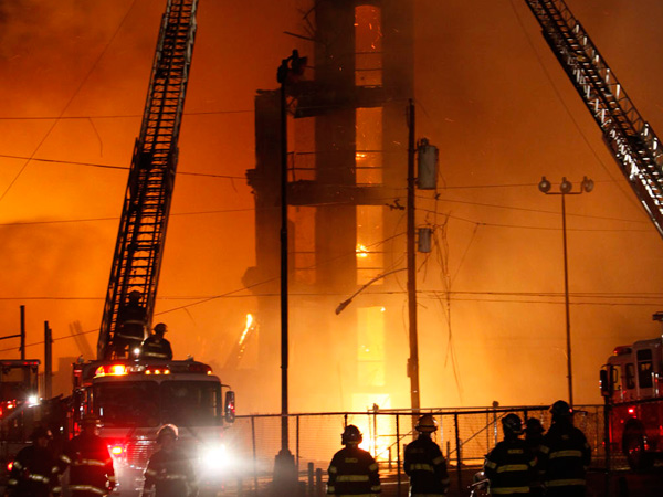 Firefighters battle a five-alarm fire in a warehouse on York Street near Kensington Ave. in the Kensington section of Philadelphia on Monday April 9, 2012.  (For the Daily News/ Joseph Kaczmarek, file)<br />