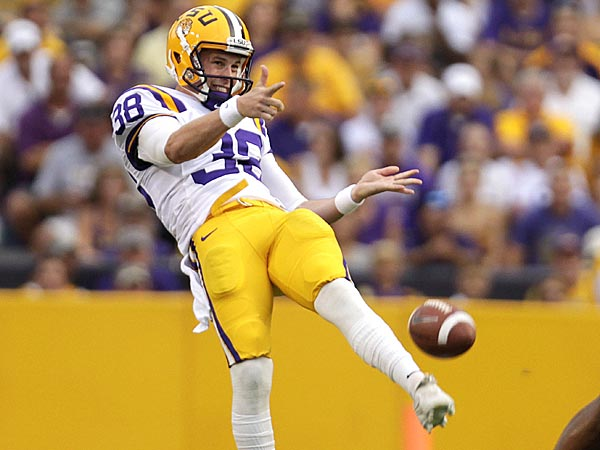 In this photo taken Saturday, Sept. 8, 2012, LSU punter Brad Wing, left, kicks during the first half of an NCAA college football game against Washington in Baton Rouge, La. (AP Photo/Gerald Herbert, File
