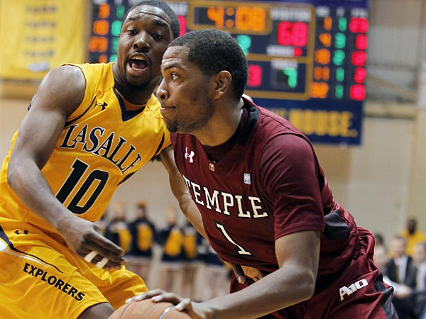 Temple guard Khalif Wyatt (1) works to get past La Salle guard Sam Mills (10) during a game in February 2012. (Alex Brandon/AP)
