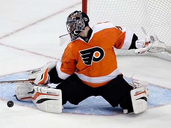 Philadelphia Flyers´ goalie Ilya Bryzgalov deflects a shot during the third period of an NHL hockey game with Carolina Hurricanes, Saturday, Feb. 2, 2013, in Philadelphia. The Flyers won 5-3. (AP Photo/Tom Mihalek)