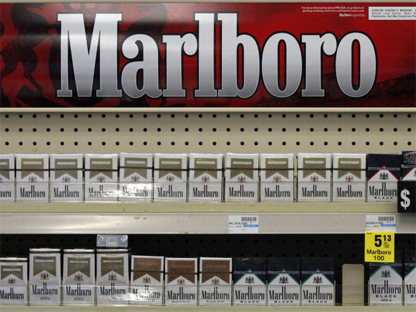 FILE - In this Wednesday, July 17, 2013 file photo, Marlboro cigarettes are on display in a CVS store in Pittsburgh. The nation´s second-largest drugstore chain says it will phase out cigarettes, cigars and chewing tobacco by Oct. 1 as it continues to focus more on health care. The move will cost the Woonsocket, R.I., company about $2 billion in annual revenue. (AP Photo/Gene J. Puskar, File)